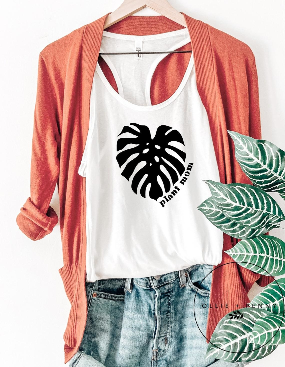 "white tank with black monstera leaf graphic and the words ""plant mom"""