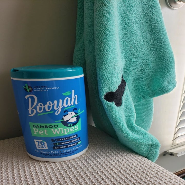a reviewer photo of the wipe canister sitting next to a blue towel
