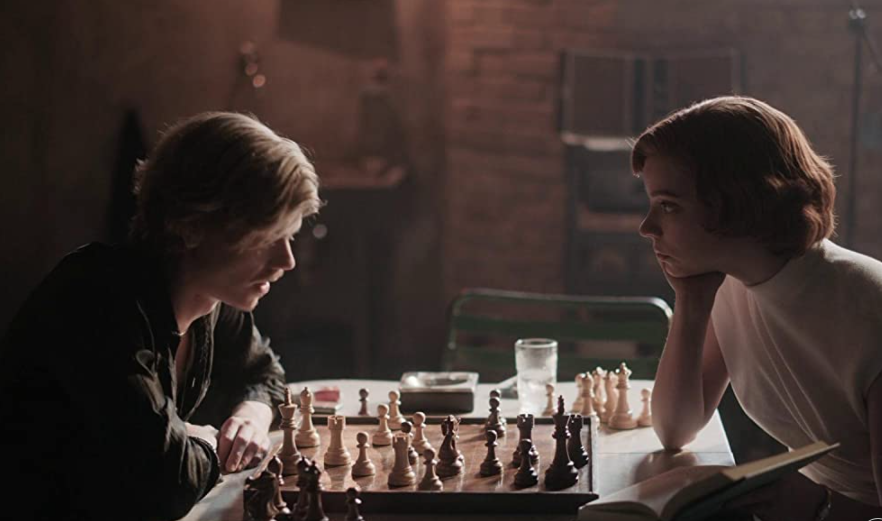 """Anya Taylor-Joy as Beth Harmon and Thomas Brodie-Sangster as Benny Watts in the show """"The Queen's Gambit."""""""
