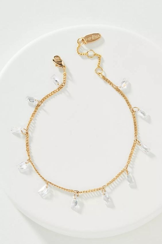 the gold bracelet with square jewels
