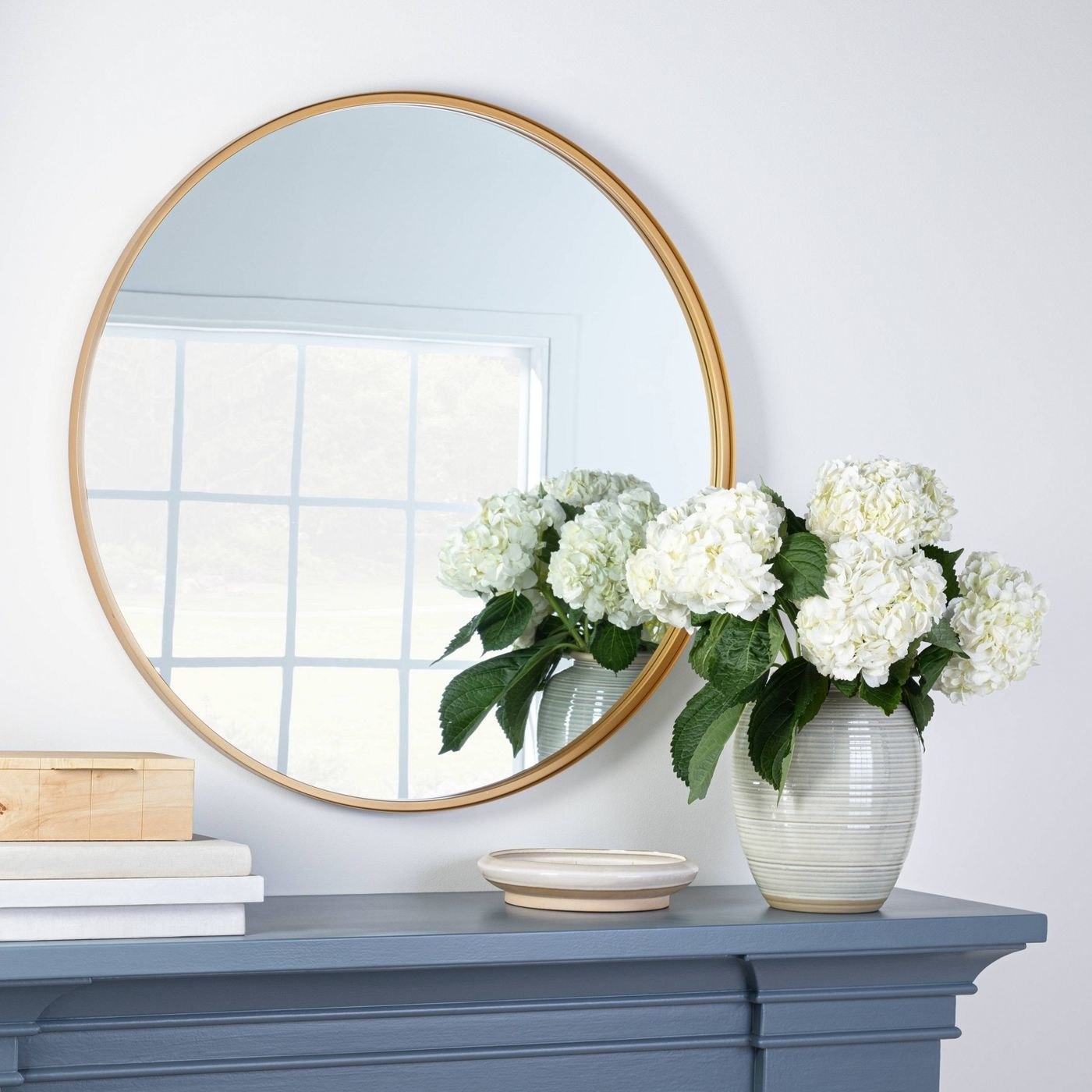 A gold–lined round mirror in home