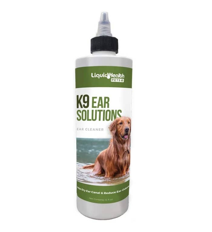 The K9 ear solution in a white bottle with a green label