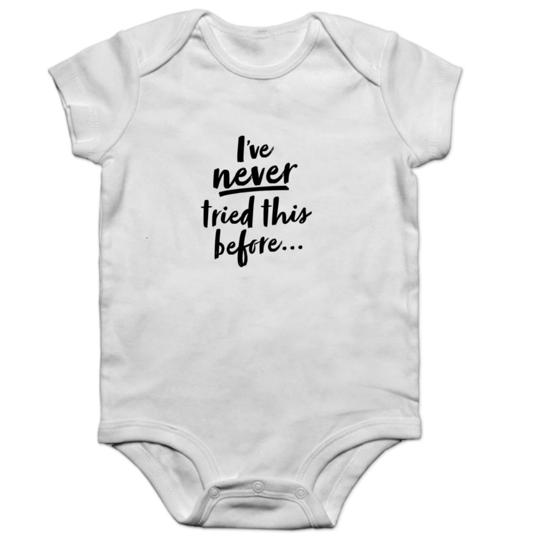 """White infant snap with phrase """"I've Never Tried This Before"""" in black writing"""