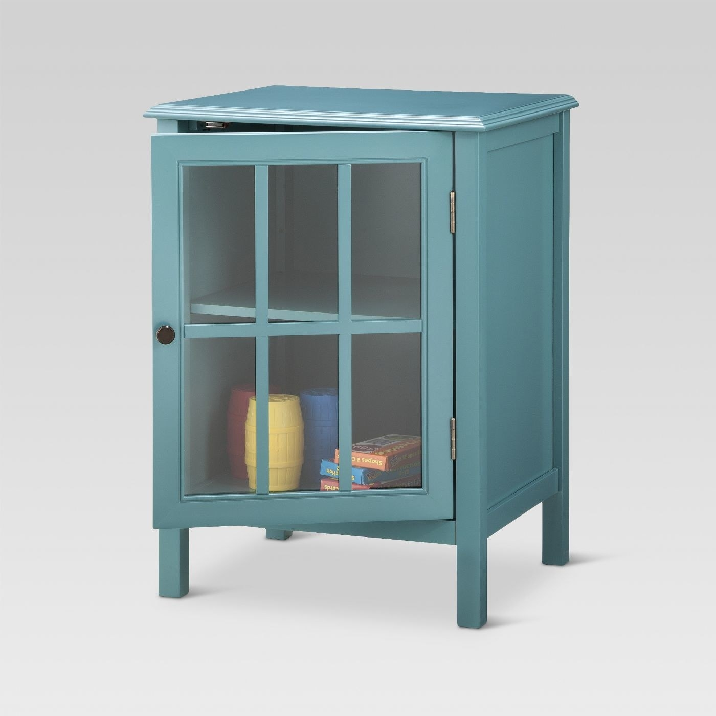 a blue cabinet with items inside