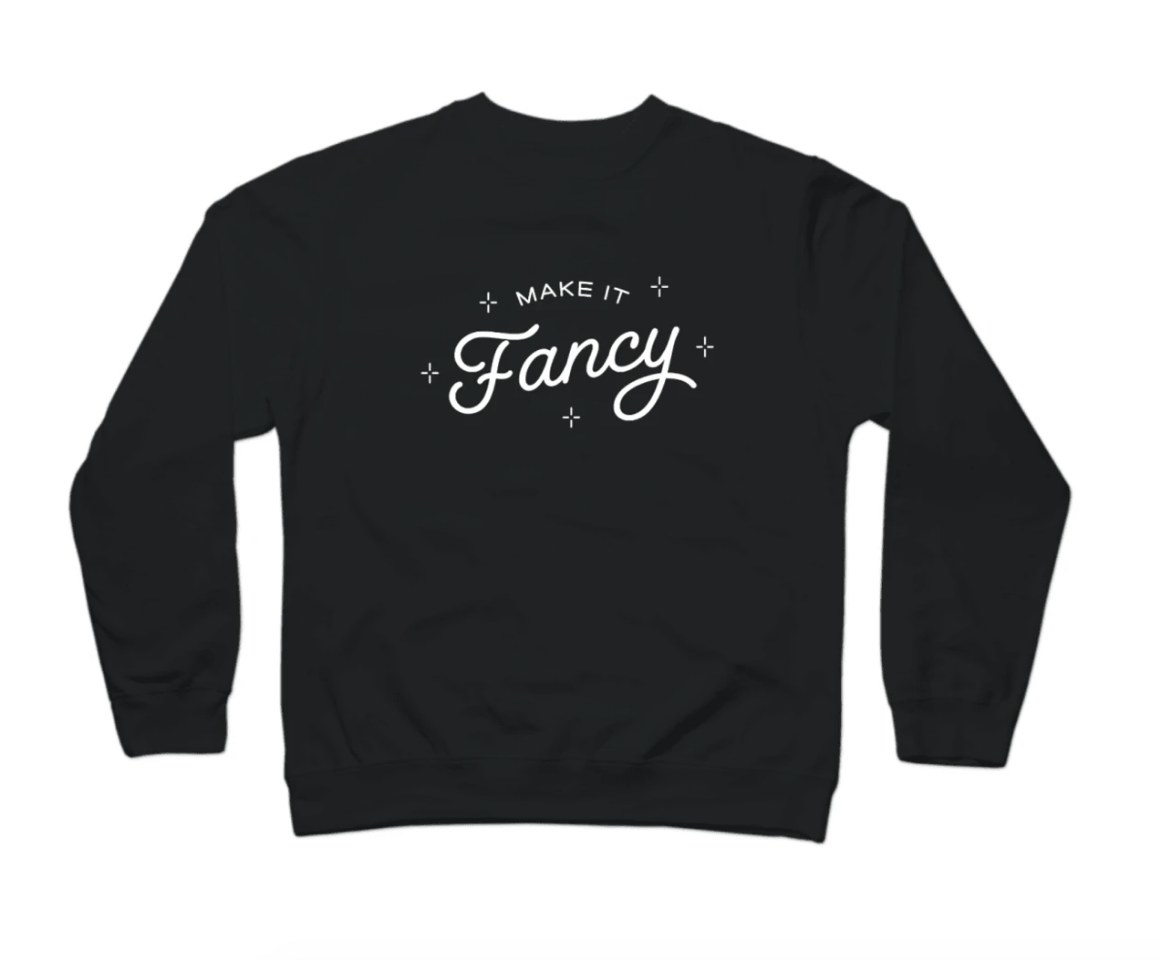 """Black crewneck with """"Make It Fancy"""" logo in white"""