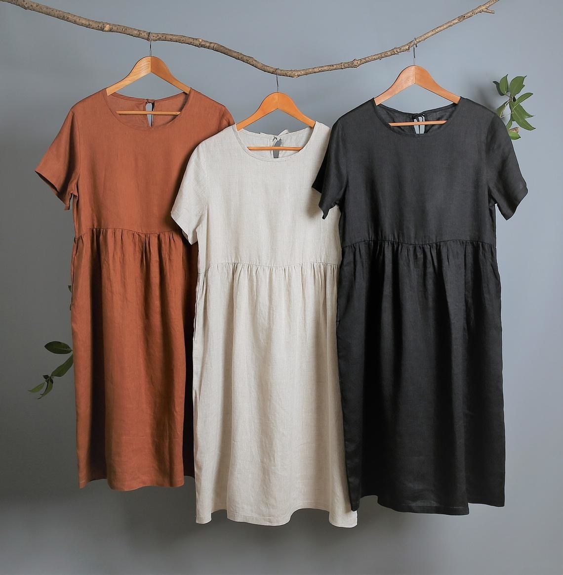 linen t-shirt dresses in rust, light taupe, and black