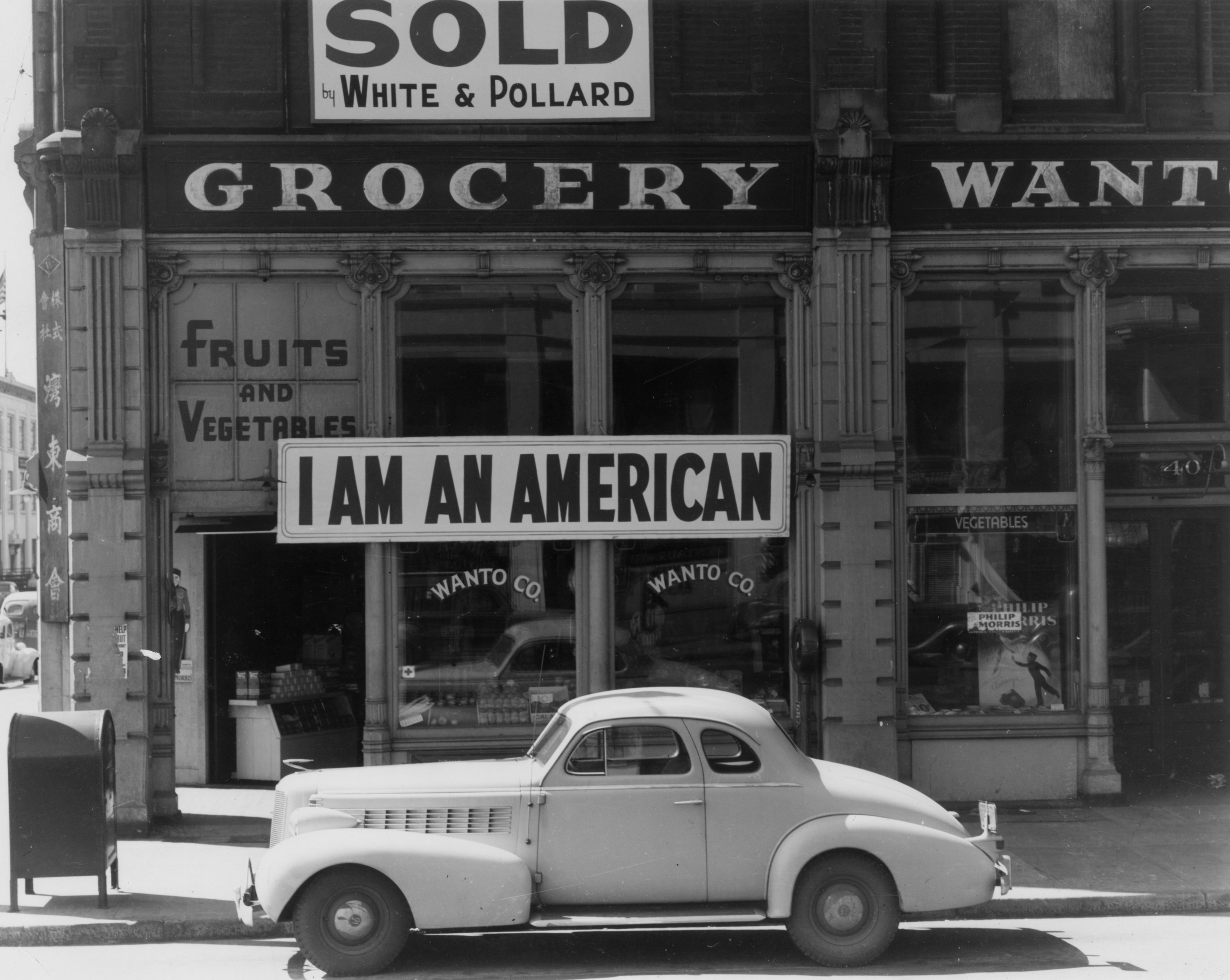 A sign reading: 'I AM AN AMERICAN', on the Wanto Co grocery store in Oakland, California
