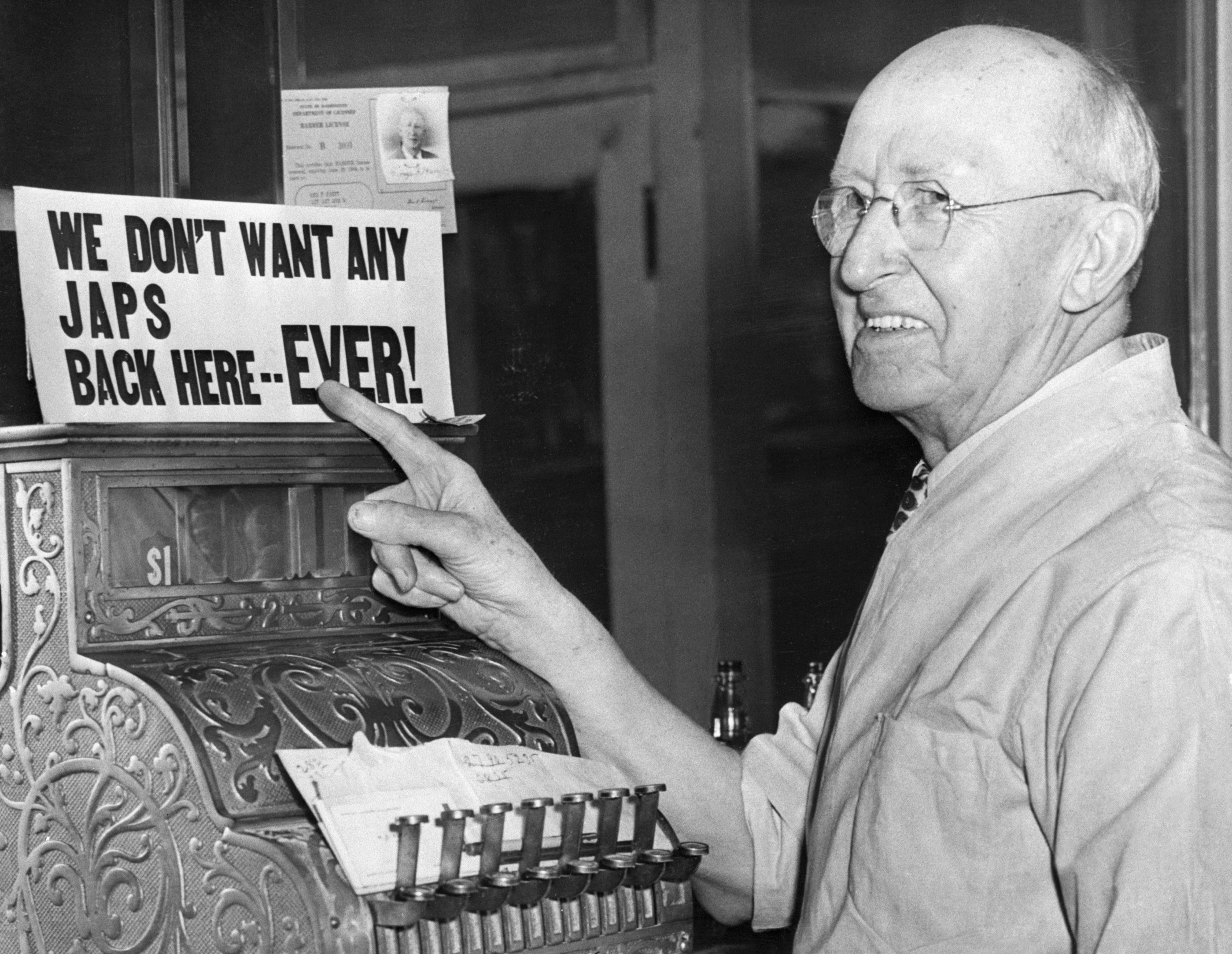"""The sign rests above the cash register and reads, """"We Don't Want Any Japs Back Here ... EVER!"""""""
