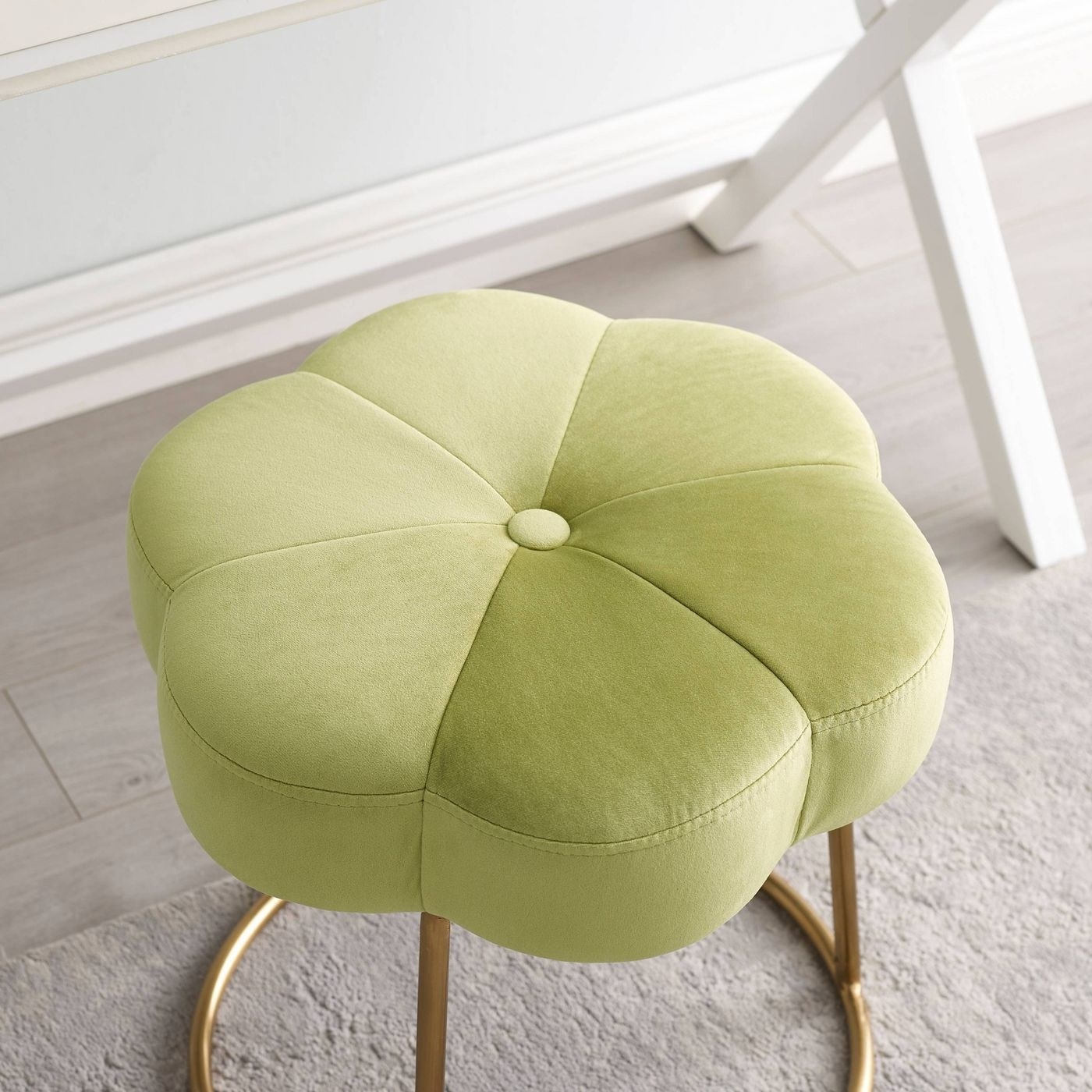 A green stool in a home