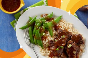 Bulgogi beef short ribs served over rice with a side of sugar snap peas
