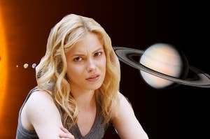 "Britta from ""Community looking annoyed and the planets behind her"