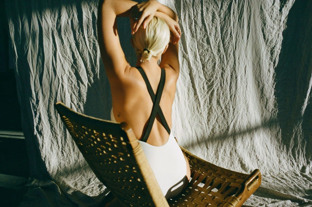 a one piece with black straps