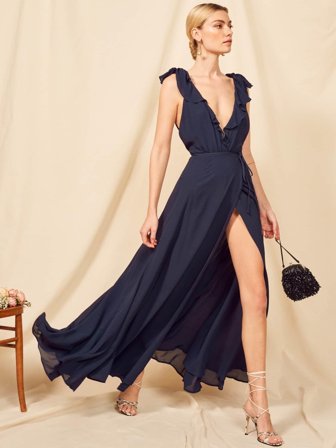 model wearing a navy blue dress