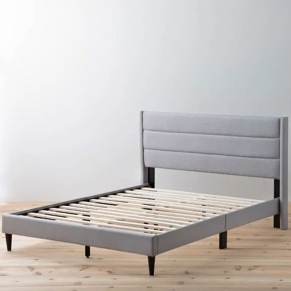 The upholstered bed in stone