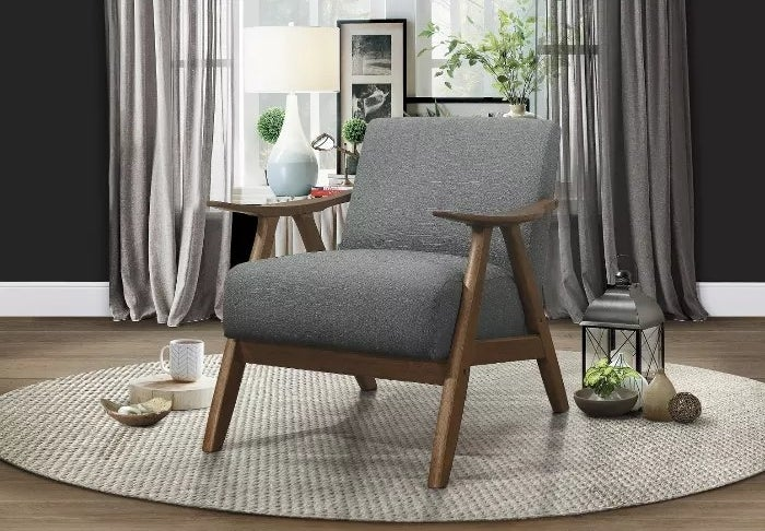 The armchair with gray upholstery