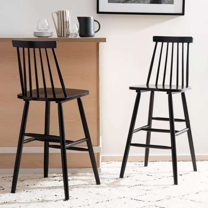 The black, spindle-back chairs
