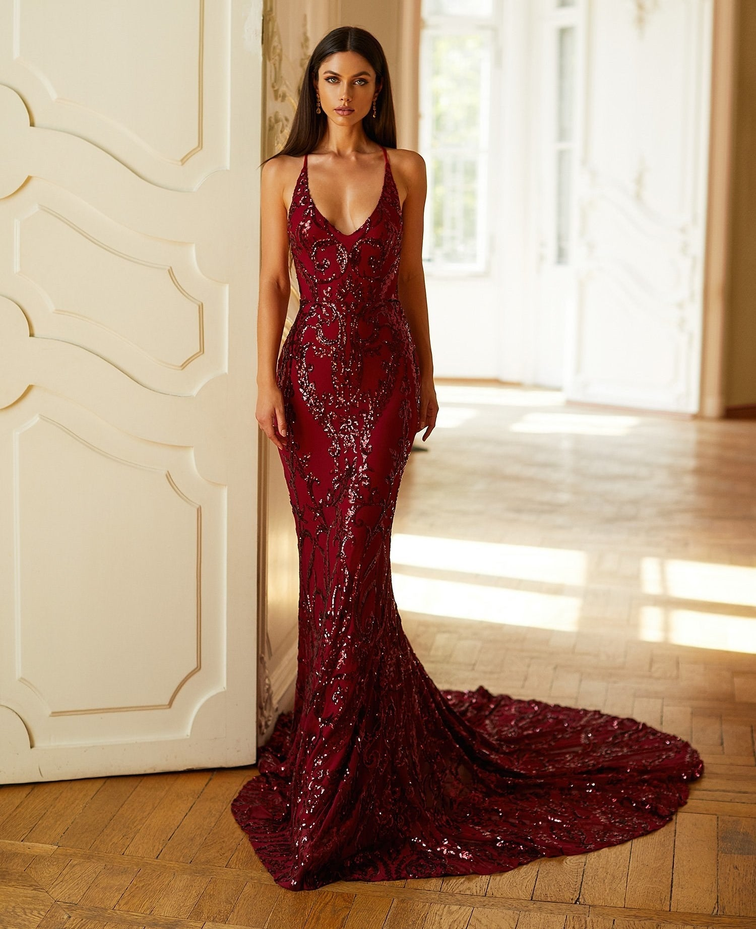 model wearing the red sequin dress