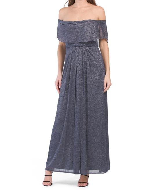 model wearing off-shoulder sparkly dress