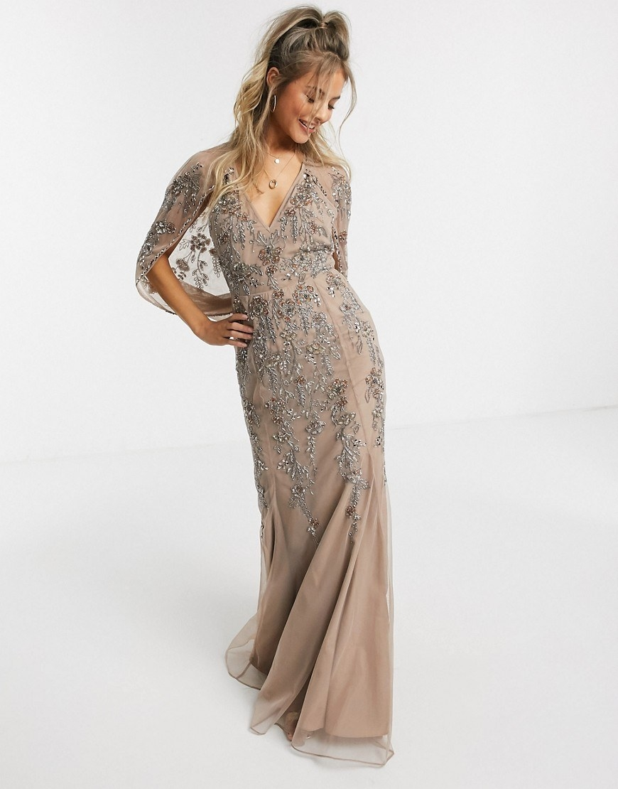 model wearing champagne colored sequin gown