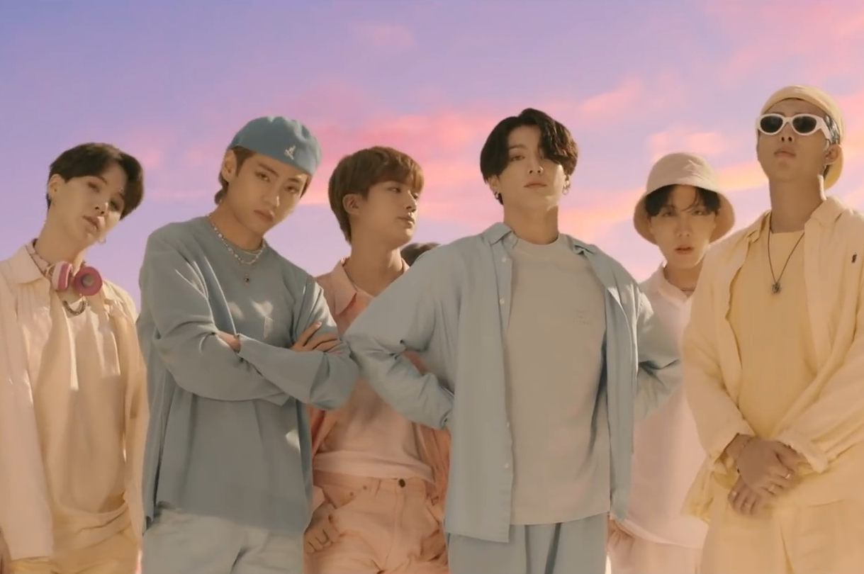 """BTS poses in the music video for """"Dynamite"""""""