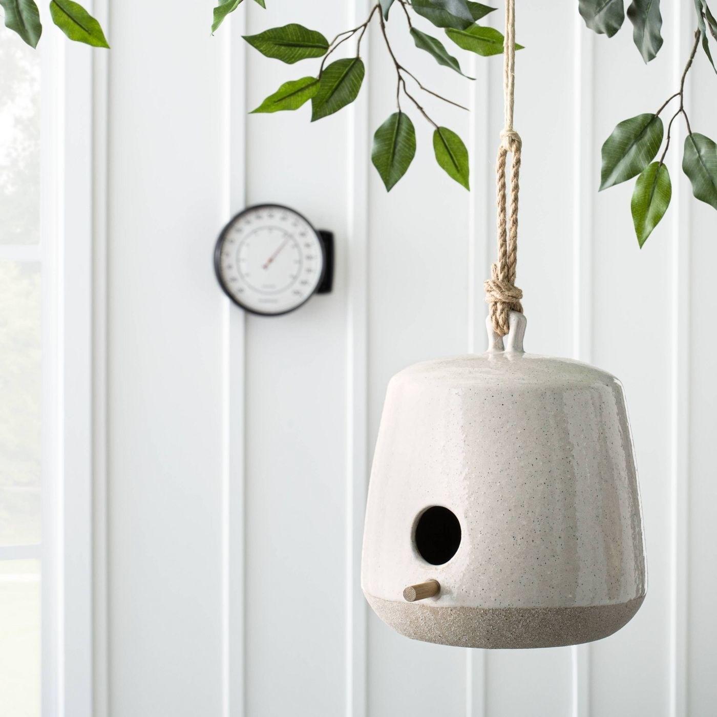 Cream colored bird house