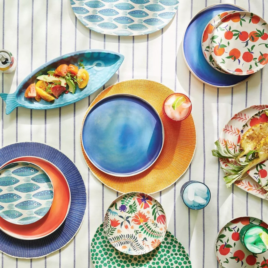 Melamine plates and serving trays printed with bright orange, blue, floral and nautical designs