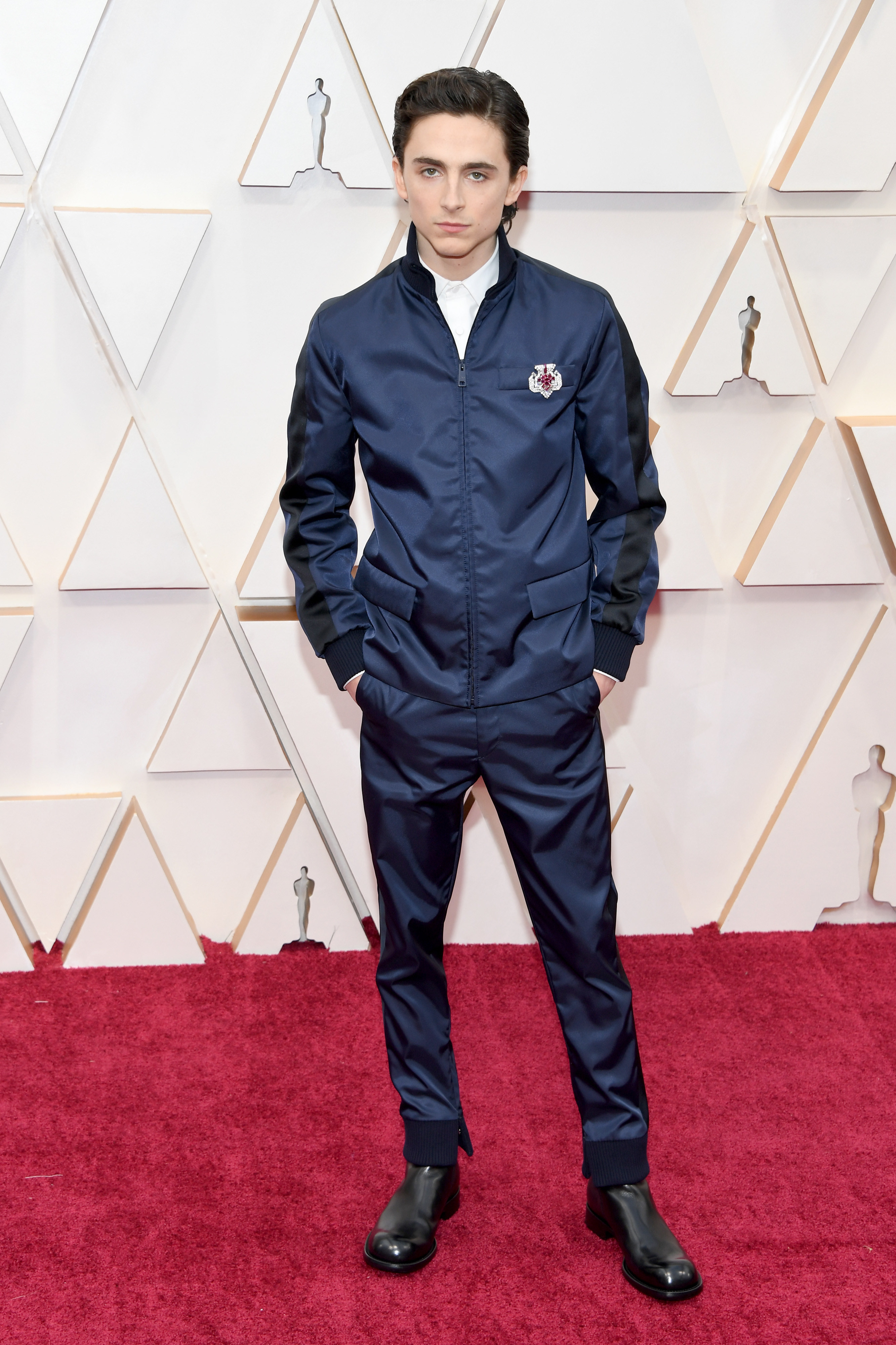 Timothee wears a blue satin outfit to an event