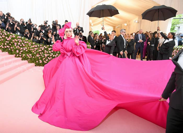 Lady Gaga wears a flowing pink dress to the gala