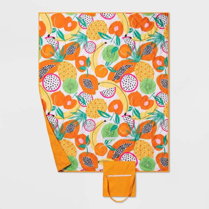 orange, yellow and green fruity picnic blanket