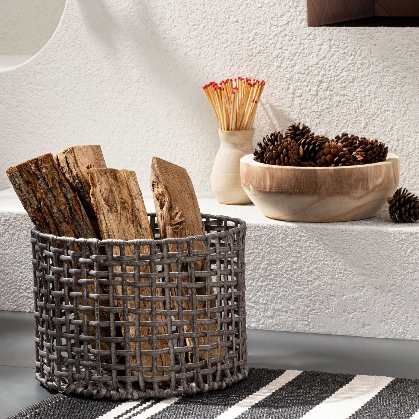 brown rattan basket with firewood