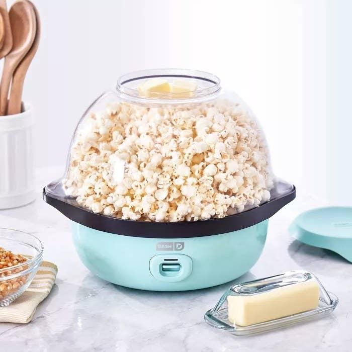 The aqua-blue Dash popcorn maker