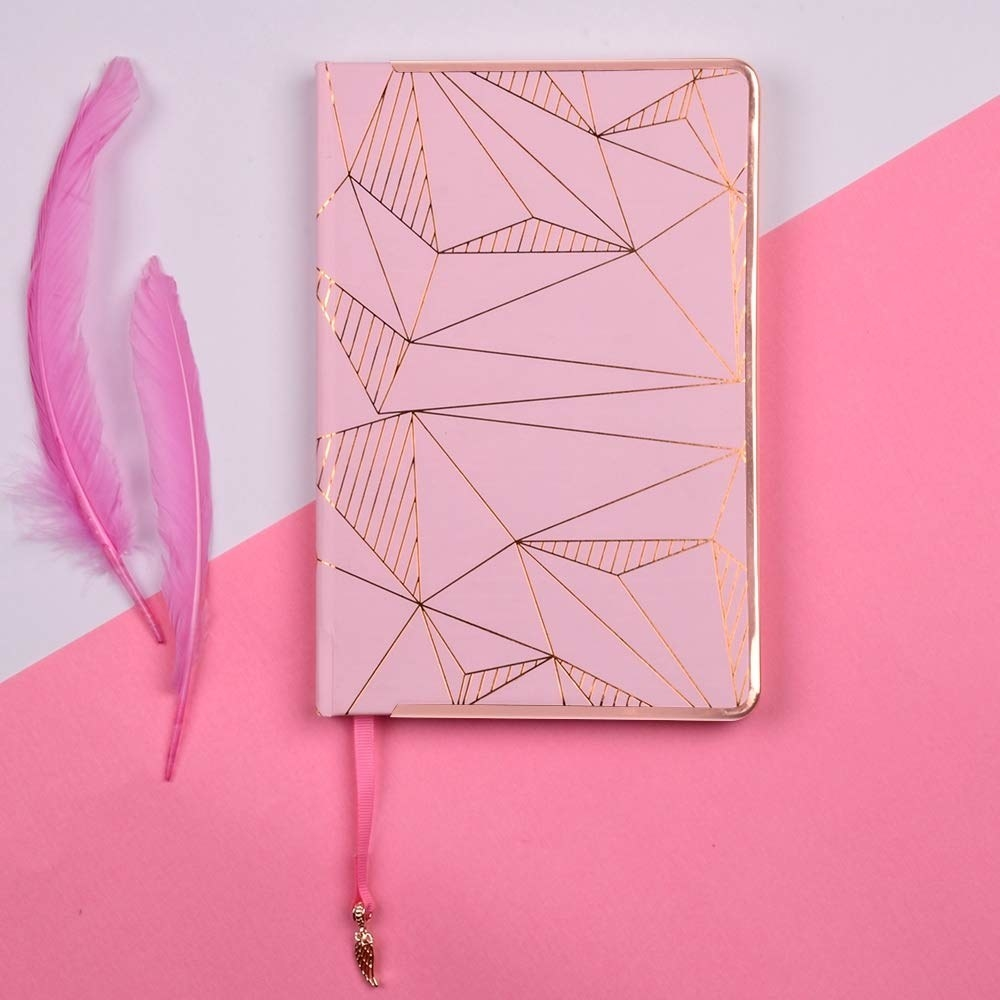 A pink and gold journal.