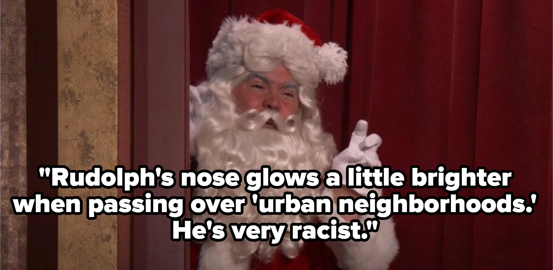 Man dressed as Santa hiding behind a wall