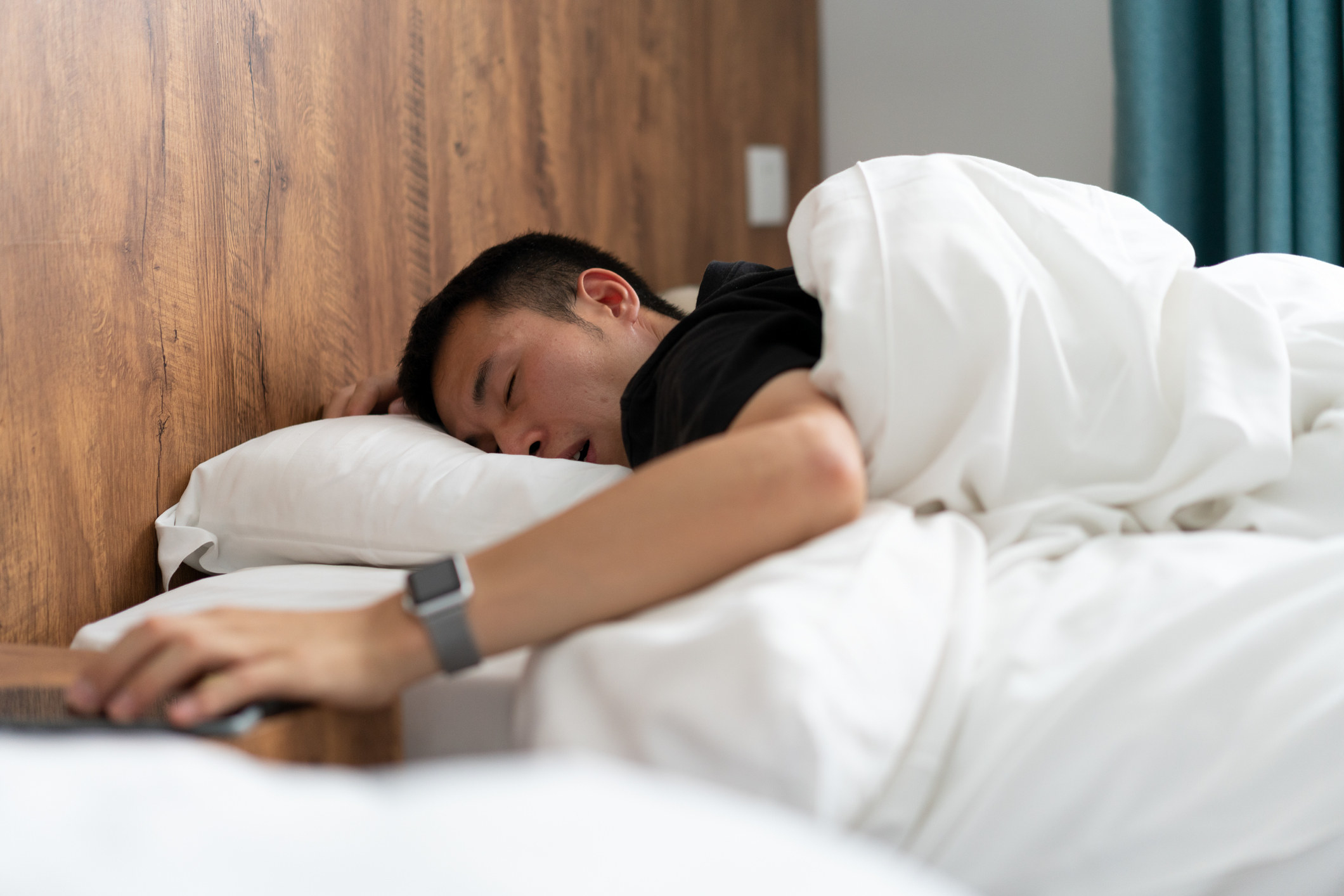 A guy asleep in bed