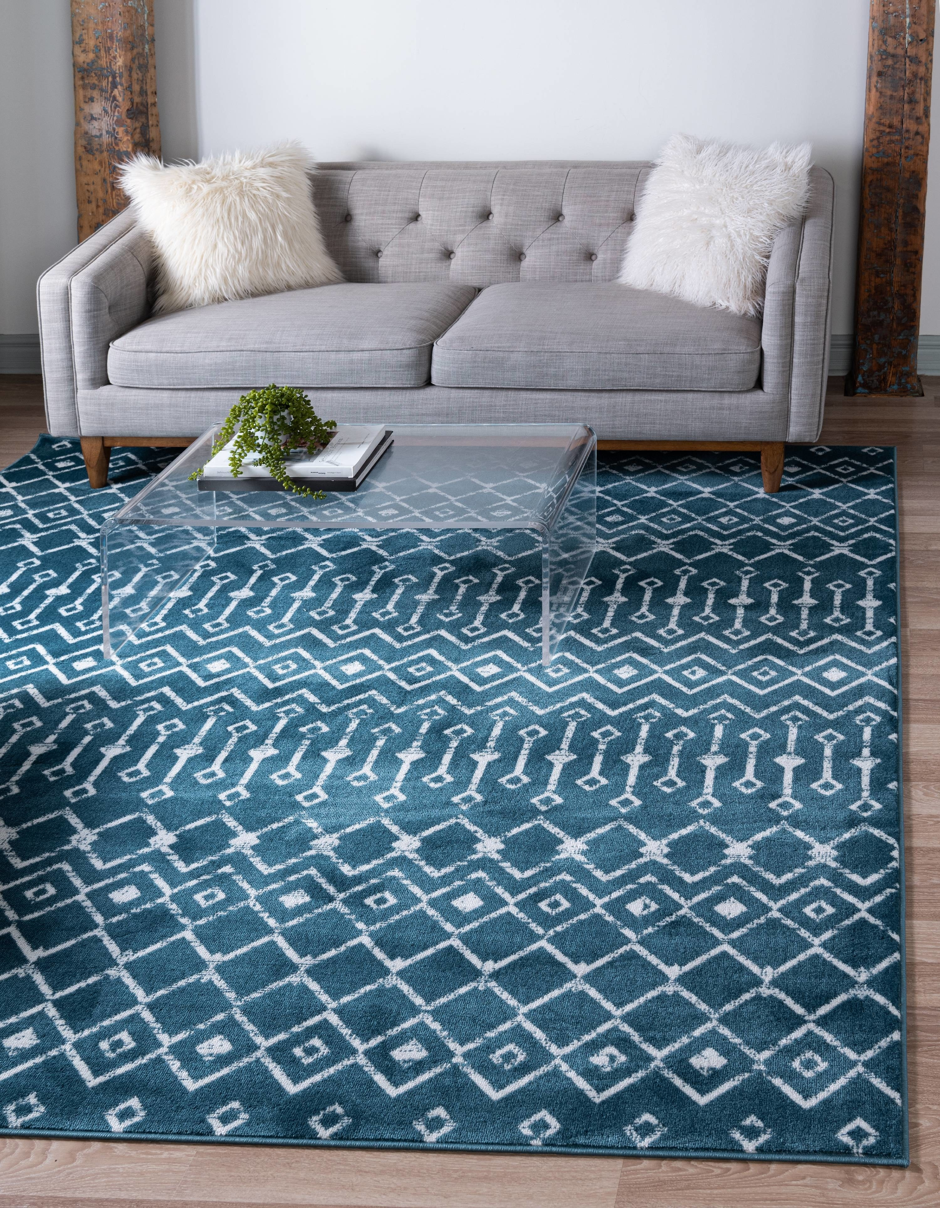 a blue rug with a white Moroccan design on it