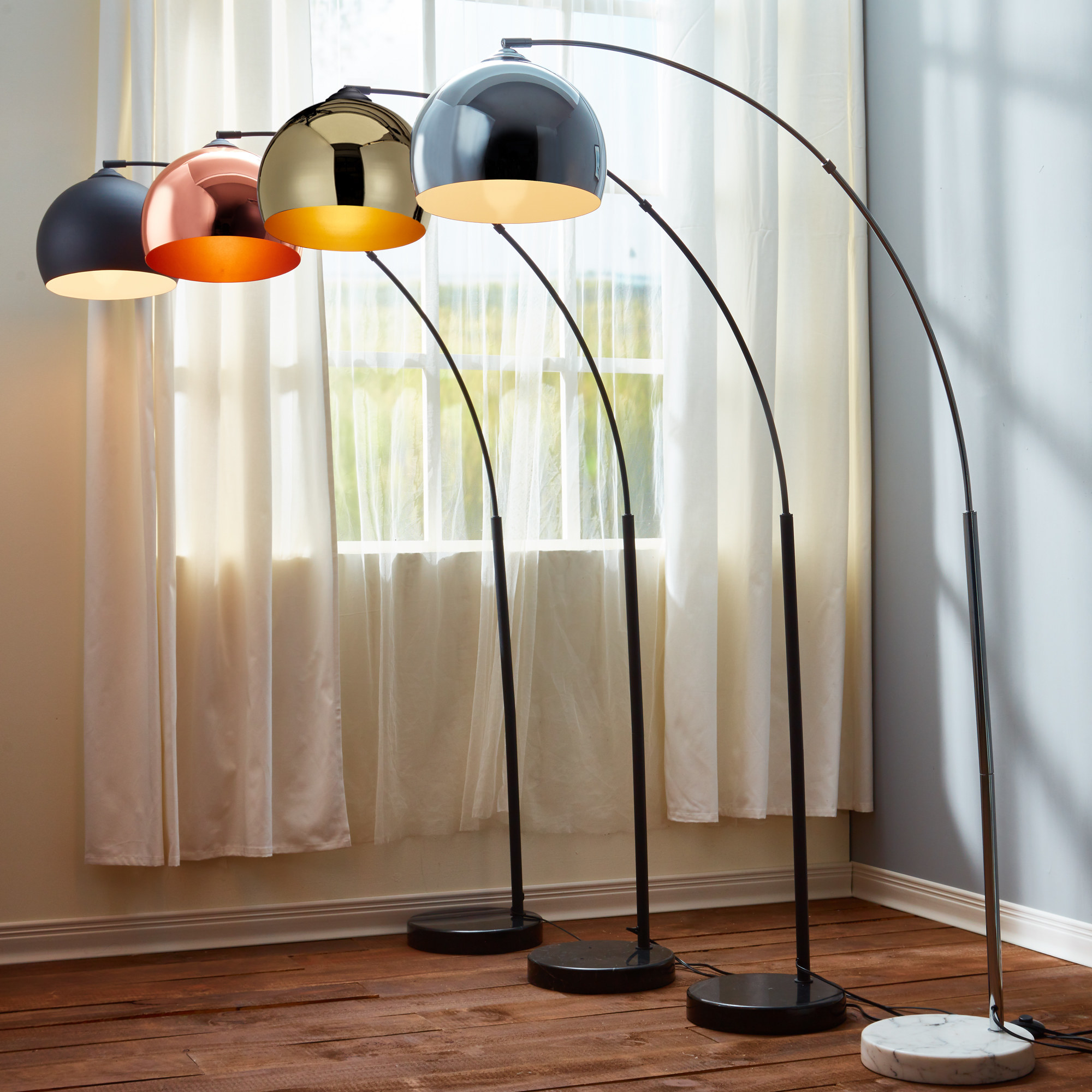 arched lamp with rounded metallic shade