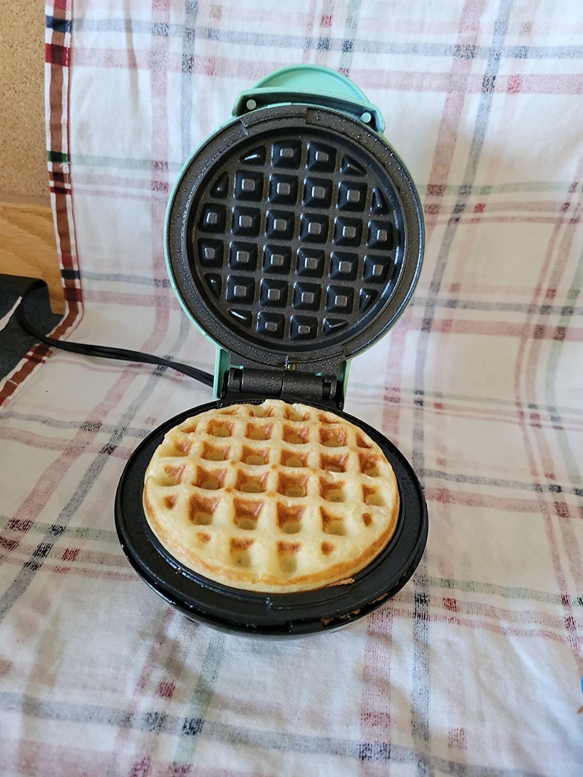 A reviewer photo of the waffle iron in use