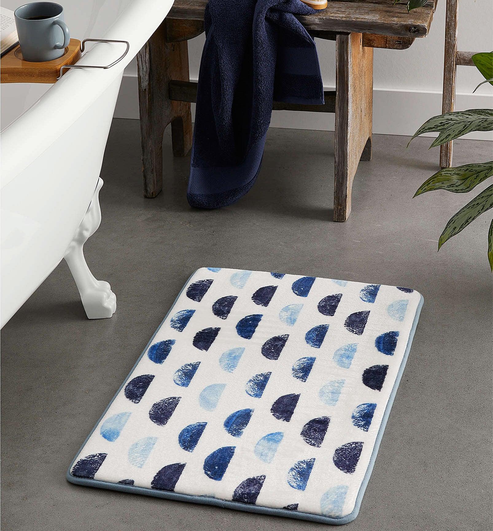 A mat next to a tub