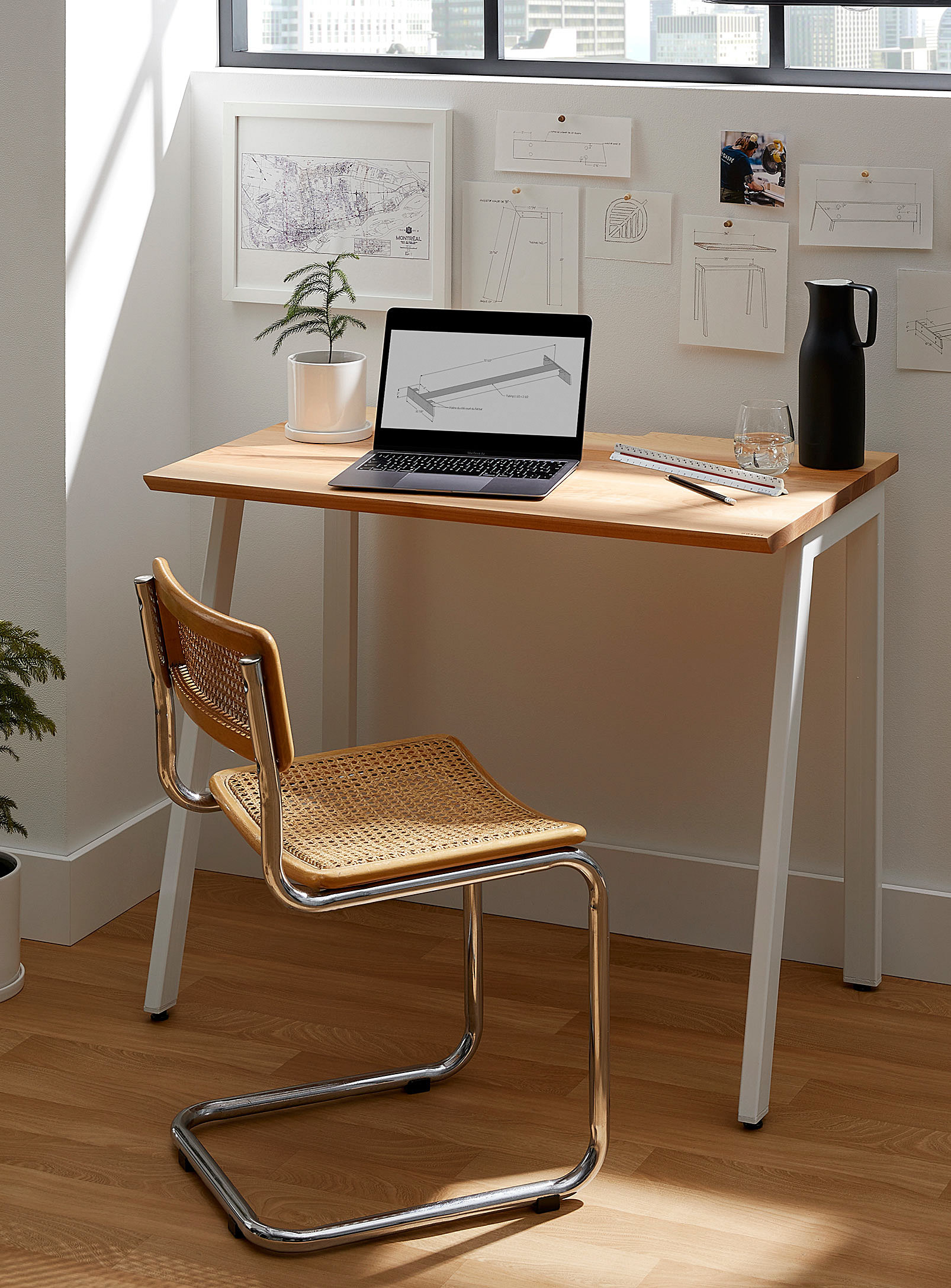 A small desk and chair by a window