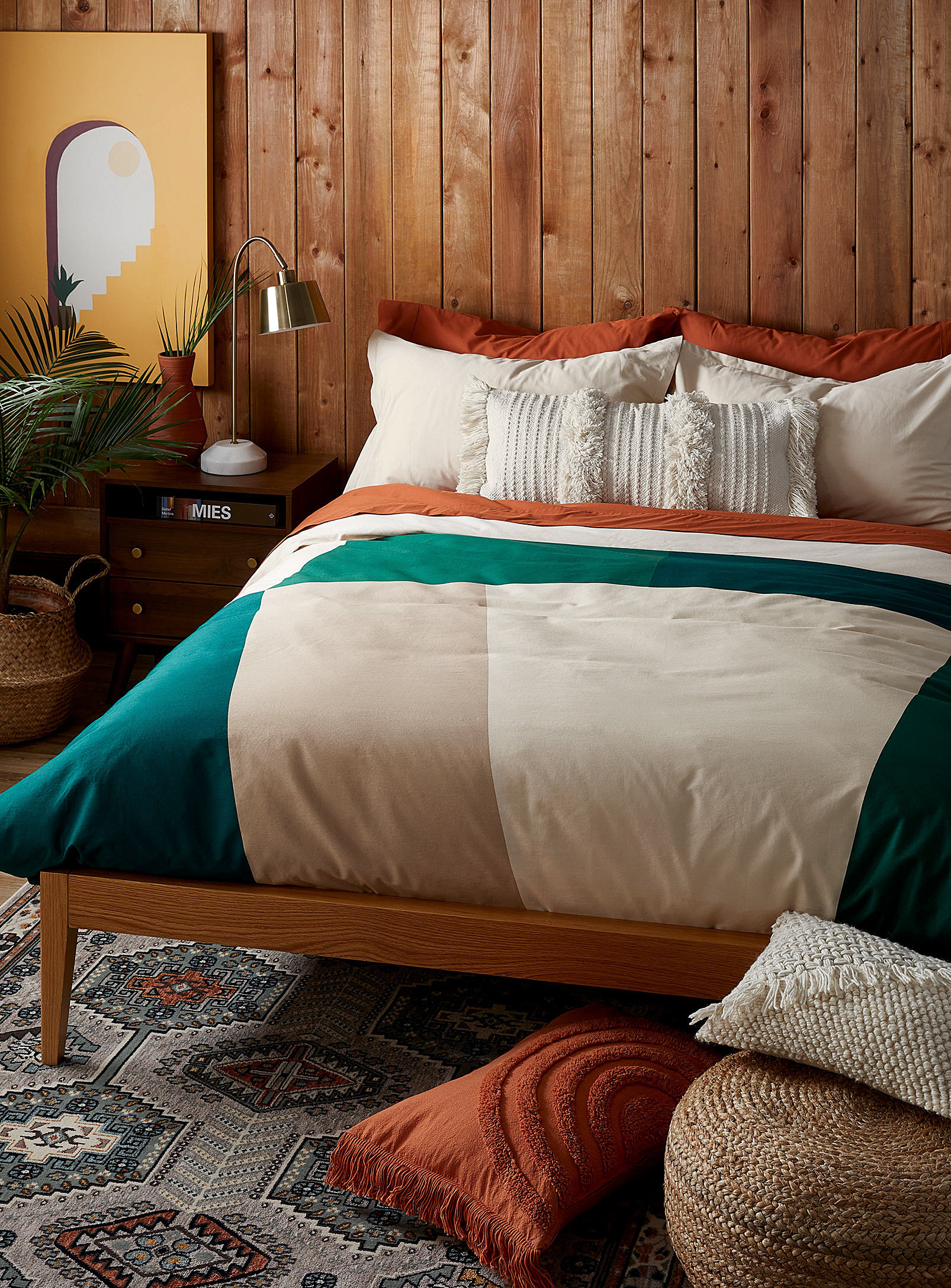 A duvet on a bed with pillows
