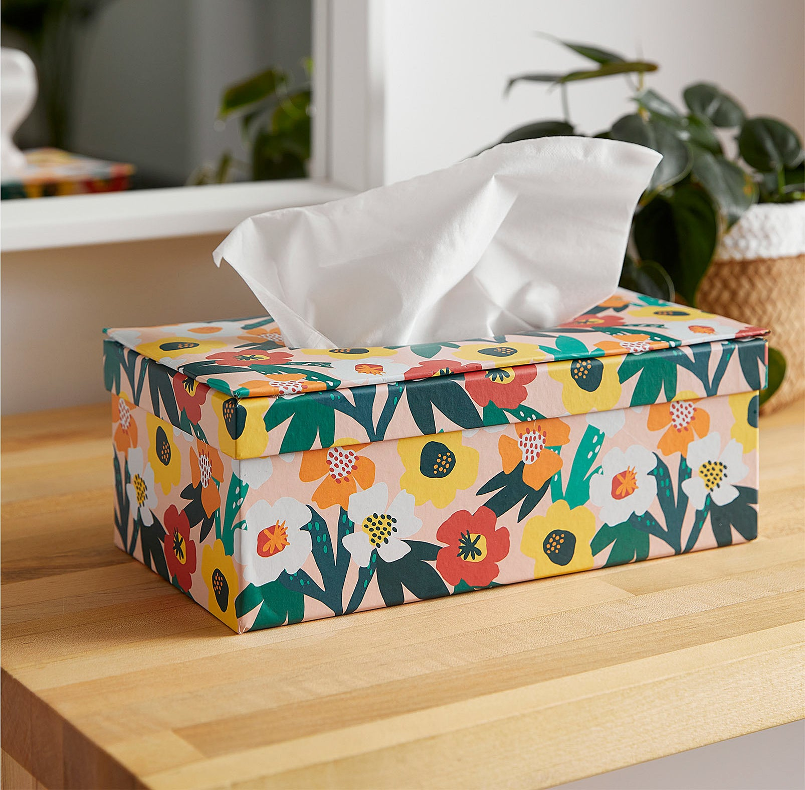 A tissue box on a wooden table