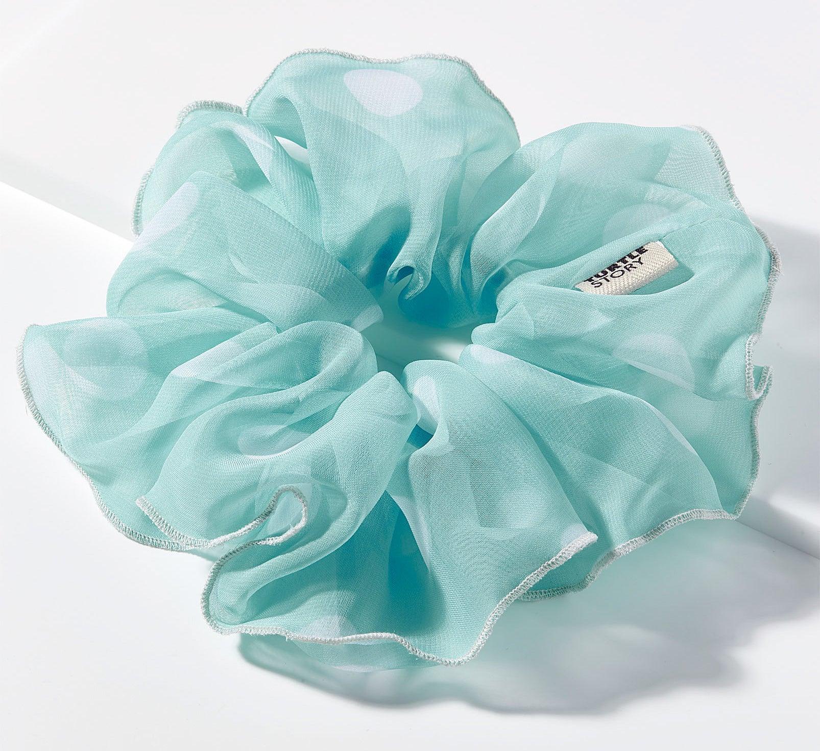 A poufy scrunchie on a plain white background