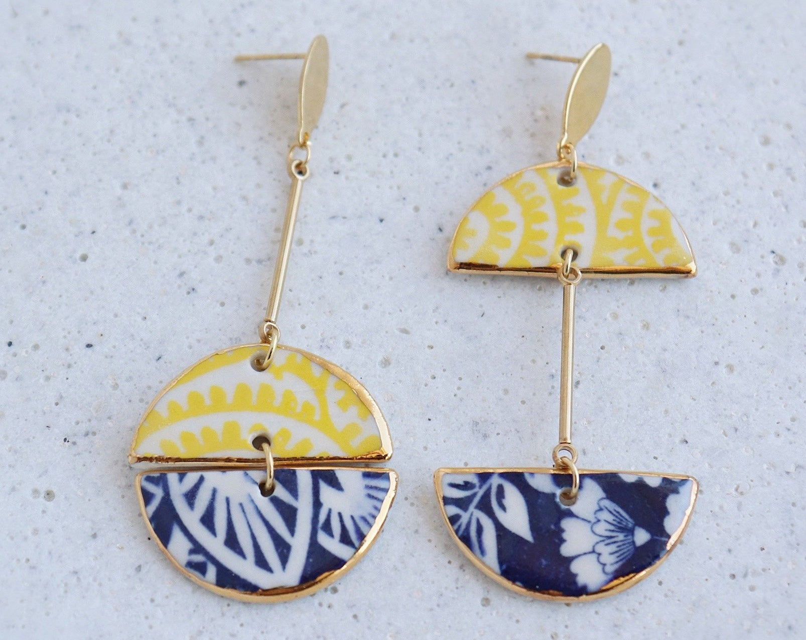 A pair of earrings on a plain background