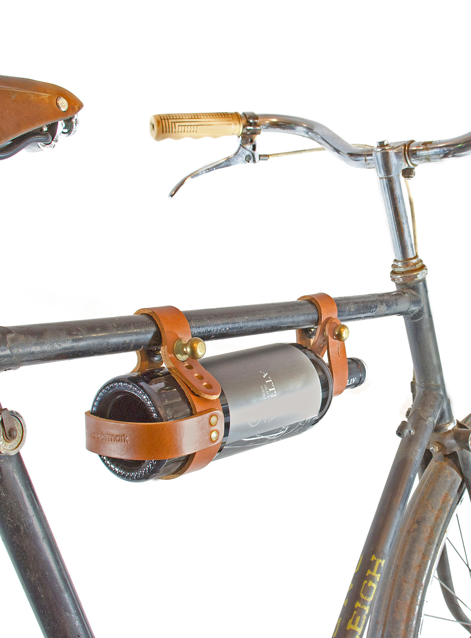 A wine bottle hanging from a bike seat with leather straps
