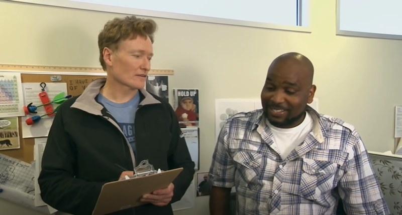 Conan with a clipboard next to staffer Chris Hayes