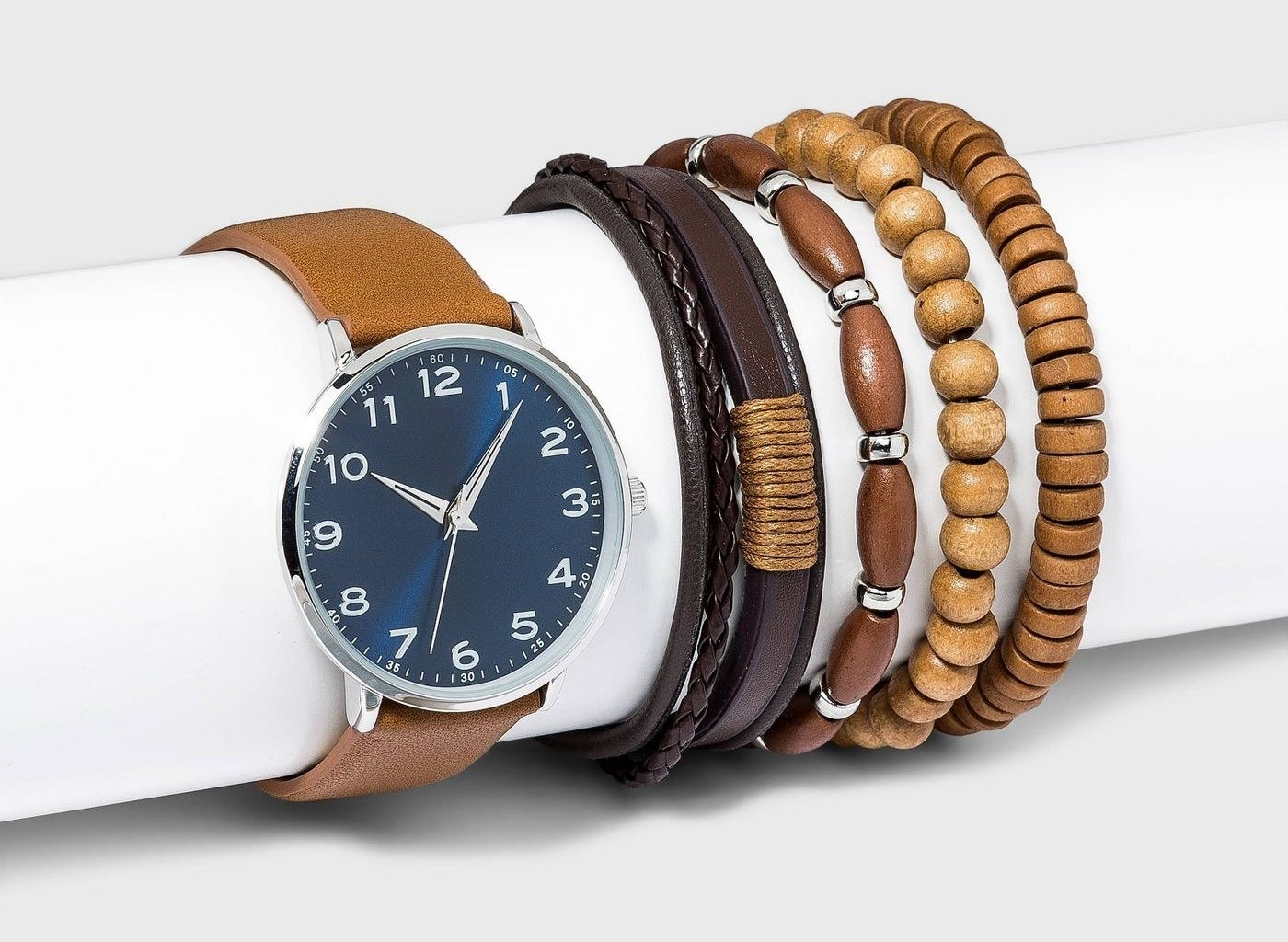 Navy watch with brown watchband and bracelets