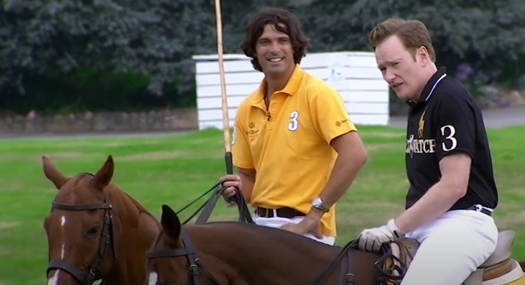 Conan on a horse next to his polo instructor on a horse