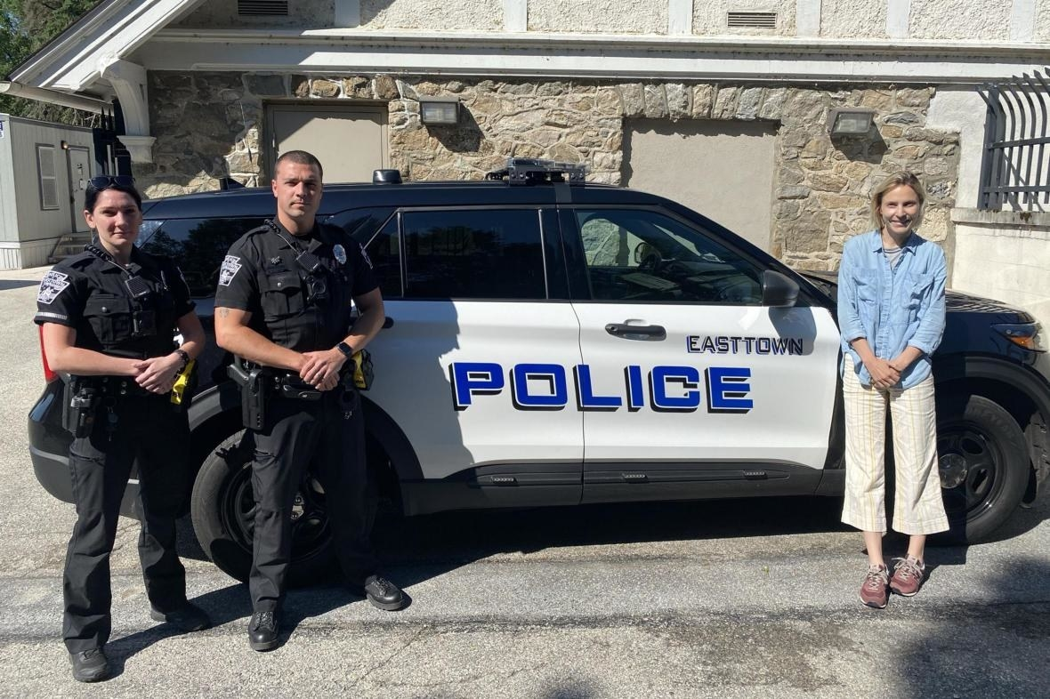 Journalist Laura Pullman, who visited Easttown, with two police officers of Easttown