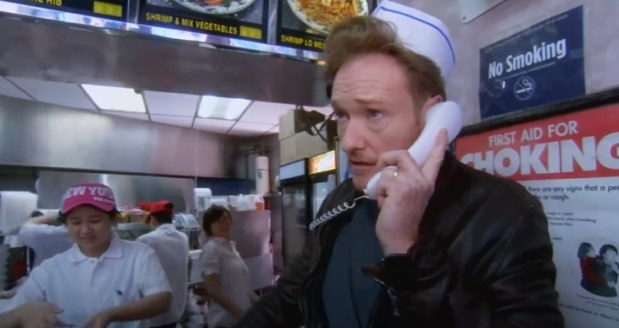Conan on the phone in a Chinese restaurant