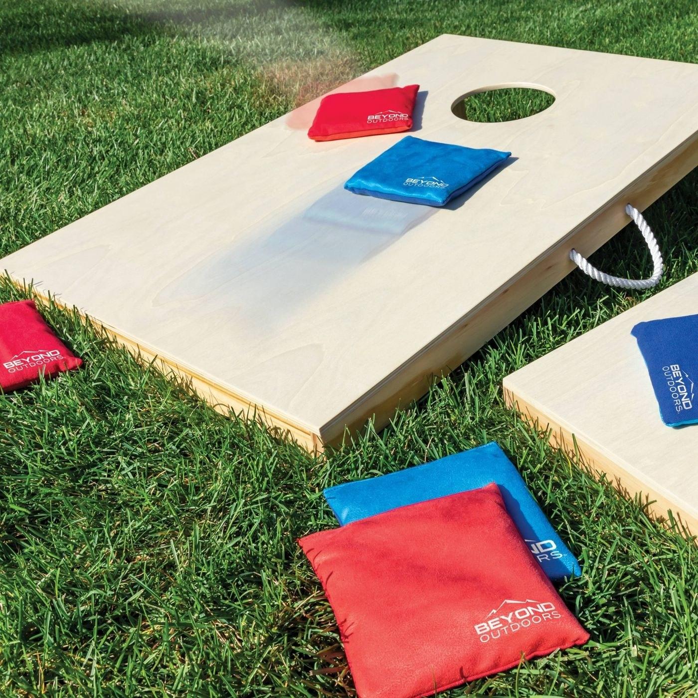 the bean bag toss set up outside on grass